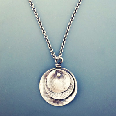round sterling pendant