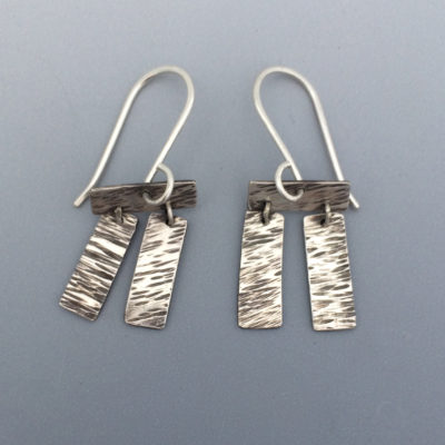 contemporary forged silver earrings